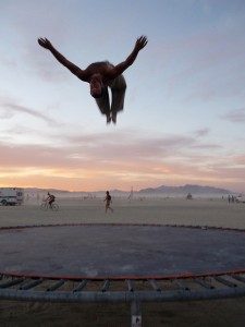 Photo of backflip taken on beach at sunset.