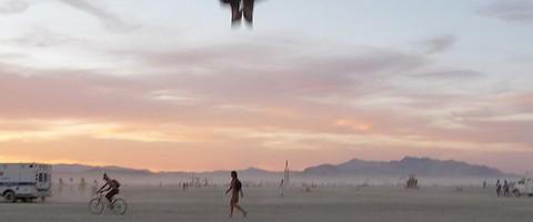 Photo of backflip taken on beach at sunset.