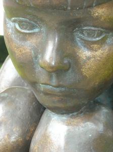 Close photograph (face) of sculpture titled 'Girl' by Robert Thomas, which stands in Gorsedd Gardens at Cardiff City Hall.