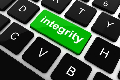 """The word """"integrity"""" is displayed as a key at the center of a standard computer keyboard, situated between the D and H keys. This images originally appeared on the Swedish Acreo ITC website at https://www.acreo.se/ensuring-user-integrity-when-handling-internet-traffic-data-1."""